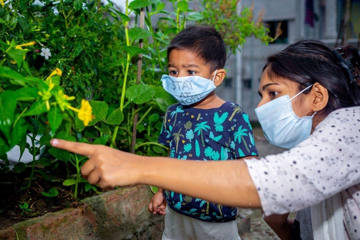 indossare mascherina chirurgica bangladesh