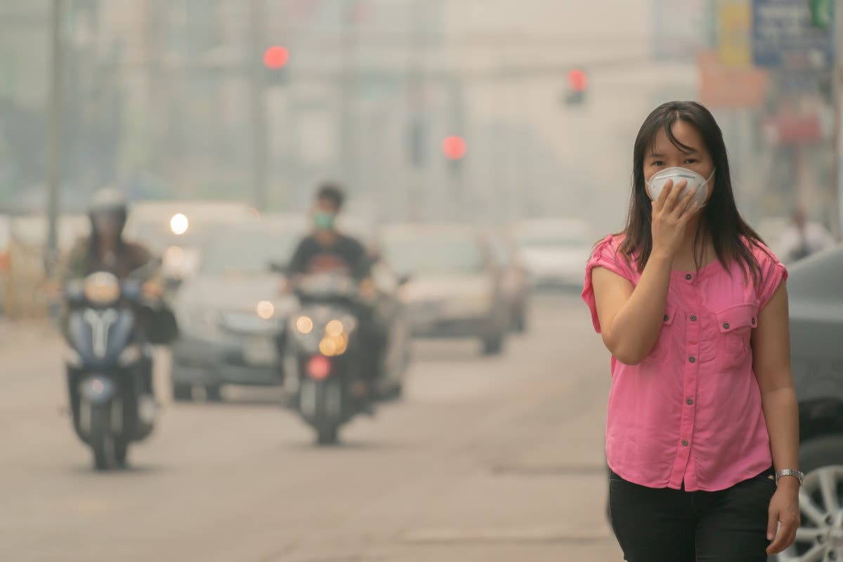 Young woman wearing protective mask in the city street, chiang mai thailand